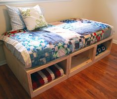 DIY guest bed or daybed with storage. Link does not show this project; but I would build in 3 sections, add bolt-on arms and back to supports pillows. Also add rail to keep mattress in place; and bolt 3 base units together for stability. Diy Storage Bed, Daybed With Storage, Diy Daybed, Diy Headboards, Easy Storage, Small Furniture, Bedroom Furniture, Diy Furniture, Guest Bed