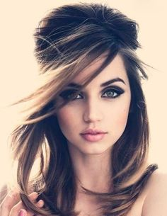 modern 60s with 80's blow out and 2000's side bangs. nude lip, dark cat eyes.