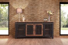 """Anton Black Finish 80"""" Rustic Sliding Barn Door TV Stand Console. Available In White and in 60"""" and 70"""" Sizes. Sliding Barn Door. 80 Wide x 19 Deep x 34-3/4 Tall. Arrives Fully Assembled. Solid Wood Construction With Multi Step Lacquer Finish."""