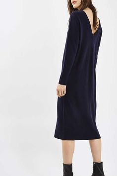 Opt for a luxury look for your basics, starting with this cashmere dress with long sleeves and a v-back. In a midi cut, it's perfect for wearing during colder months with a puffy bomber jacket and white trainers. #Topshop