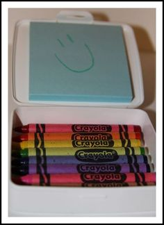 post it and crayons in a soap box