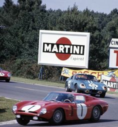 The Pierre NobletEdgar Berney Grifo ahead of the #5 Dan GurneyBob Bondurant Shelby Cobra Daytona Coupe 4th with the nose of the #24 Lucien BianchiJean Blaton Ferrari 250GTO 5th during Le Mans 1964