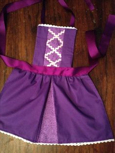 My version of a Rapunzel Disney Princess Aprons, Disney Aprons, Disney Dresses, Princess Dress Up, Dress Up Aprons, Dress Up Outfits, Kids Outfits, Sewing Projects For Kids, Sewing For Kids