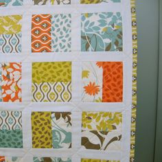 Very cute! easy if you just sew jelly roll strips together and cute them into squares, add jelly roll or honey bun strips as sashing...ta-da!!