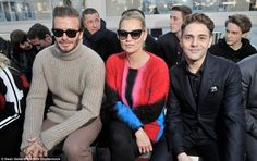 Three's company: Kate was sandwiched between David and French actor Xavier Dolan on the fr...