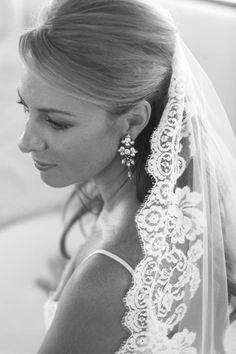 LOVE how she is wearing this mantilla!  This is a great idea :-) wedding