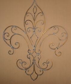 Metal Wall Decor / Wrought Iron / Fleur de lis by Theshabbyshak, $34.00 - pair it up with my New Orleans painting of the French Quarter for the dining room