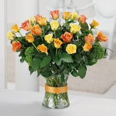 Look for arrangments that will make the most impact with flowers and color combinations, rather than trying to fill large spaces with a lot of small vases here or there.