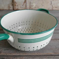 FRENCH ENAMEL CREAM AND GREEN COLANDER.  Wish I had one that had a handle like this one.
