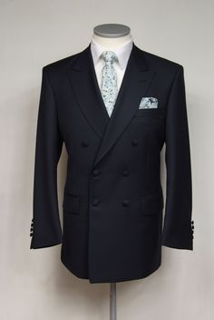 Grooms wedding suit   Light weight navy wool double breasted suit. shown with liberty print tie and made to measure shirt.  suit from  £545.00 #groom #wedding #suit #bespoke #madetomeasure #navy #doublebreasted