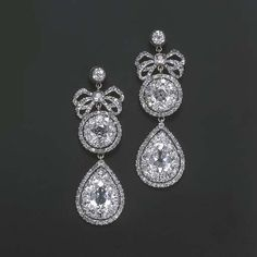 A PAIR OF VERY FINE 18TH CENTURY DIAMOND EARRINGS   Each designed as a detachable drop-shaped cluster pendant to the diamond bow, cluster and collet top, mounted in silver, circa 1770, 6.0 cm. long