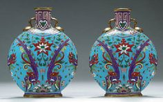 A PAIR OF MINTONS TURQUOISE-GROUND PILGRIM FLASKS  DATE CYPHERS FOR 1873 AND 1874, IMPRESSED UPPERCASE MARKS, PRINTED PUCE CROWNED GLOBE MARKS, MODEL NO. 1348, THE DECORATION DESIGNED BY CHRISTOPHER DRESSER