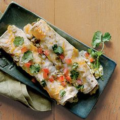 This recipe tops chicken enchiladas with a quick green chile cream sauce and colby-Jack cheese for a twist on traditional enchilada sauce.