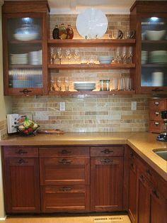 tiled the back splashes with Honey Onyx marble subway tiles,
