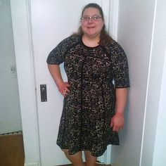 Gwynnie Bee member Rebecca in the Taylor Dresses Fit & Flare Sweater Dress in Rose Print