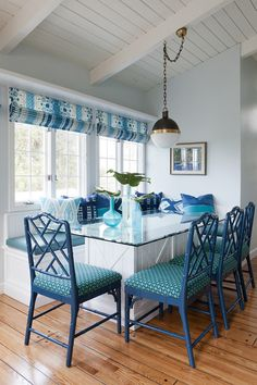 Another example of roman shades (these are flat roman shades) in the dining…