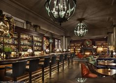 Scarfe's Bar at Rosewood Hotel, London  - Guests at Scarfe's Bar can while away a cold afternoon nestled in a cosy velvet armchair while sipping on cocktails and dining on curry. Patrons can also have a read as the shelves are filled with over 1,000 books hand-picked by an antiques dealer