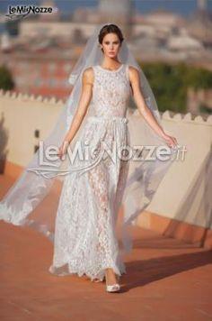 http://www.lemienozze.it/operatori-matrimonio/vestiti_da_sposa/abiti-sposa-roma/media/foto/2  Abito da sposa in pizzo