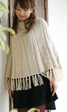 Free knitting pattern for Diamond Cashmere Poncho  The diamond pattern and fringe of the Poncho designed by Pierrot Yarns for DK yarn is topped off by a collar.