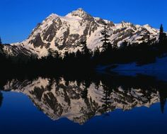 winter snow lake water reflection tree mountain