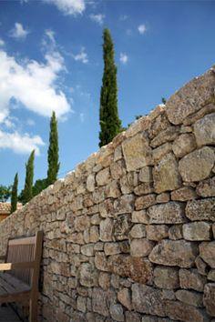 Pierre, cipres et ciel bleu. C'est la Provence!