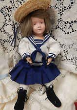 Antique wooden Schoenhut doll, dated 1911, with multiple outfits, some original