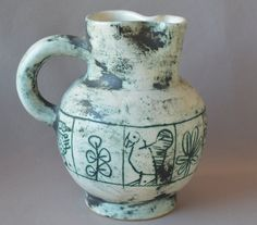 This is a vintage pitcher made by a famous French modern artist: Jacques Blin (1920-1995). It is decorated with stylized birds and and foliage. It is in perfect condition. Please take a close look at the photos, they are an integral part of the description.  Height: 5.15 inches Diameter: 4.09 inches