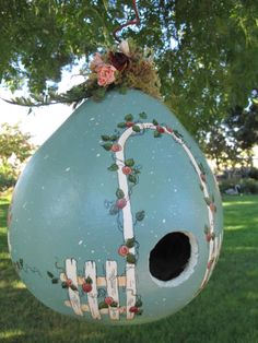 Painted gourd bird house with rose arbor!