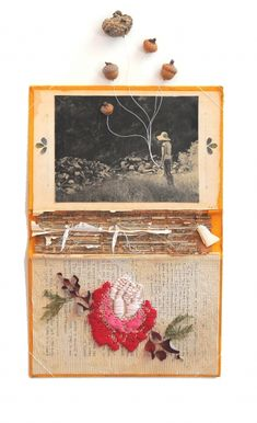 'Dixie' by Nina Garner, 2011. Coffee stained silver gelatin print with paper, lace, dried leaves, thread, acorns and hand embroidered rose on book cover.