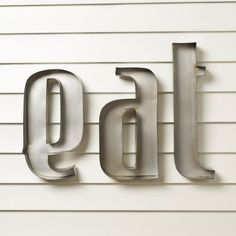 """Eat Wall Decor from Birch Lane. Whimsical, retro style lower case letters finished in a satiny gray metal sheen. Made of iron. Overall dimensions: 17.5""""H x 20""""W x 2.25""""D. $89.00"""
