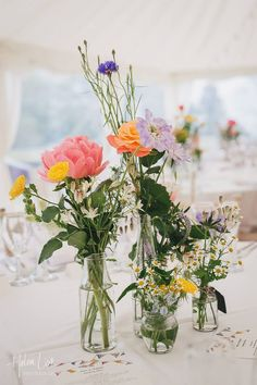 Beautiful, simply wedding marquee flowers in jam jars. Devon and Cornwall Marquee Hire from Hatch Marquee Hire