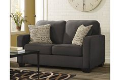 The sleek mid-century lines of the Alenya loveseat are always in vogue. With neatly tailored box cushions and track arms, the microfiber upholstered loveseat is supremely comfortable and stylish. Tonal piping and a pair of printed pillows further refine the silhouette.