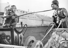 THE CLASSICAL ALIBI IN PHYSIQUE PHOTOGRAPHY / Charriot Race, 1925 -- I love the wings on the charioteer on the left...  I think I could do without the whip, though.