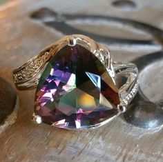 Mystic Rainbow Topaz ring Gorgeous big triangle shaped mystic topaz stone beautifully set in a 925 silver setting Jewelry Rings