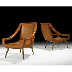 MAXIME OLD  Pair of lounge chairs, France, 1960s  Leather, sycamore