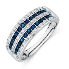 Exude elegance and sophistication with this 10kt white gold ring. Featuring alternating rows of claw set round brilliant diamonds, and channel set sapphires, this gorgeous piece will set you apart.
