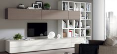 "'Open' Independent Living Solution. Doors: Matt Lacquered in Prestige SCAV028 & Veneered in Tundra Grey Oak SCAV357. ""Fluida"": Decorative Melamine Pure White SCAV021."