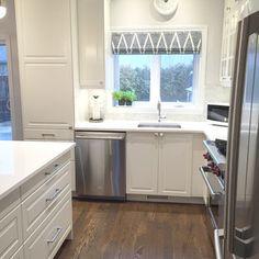 Stephanie Fortier Design / Ikea white kitchen with quartz countertops.