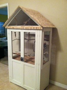I have seen a couple of these and I think I am going to try this... DIY birdcage made from an old cabinet