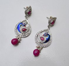 Dear buyer, If you like any item at your first look then just grab it because i believe that first look is always a heart look, So before any other buyer just purchase it :-)  ===========================================================  Sterling Silver Earring With White Topaz,Ruby Gemstone, Pure Traditional Jewelry,Enamel,Ruby Beads At Good Price,Free Shipping  ===========================================================  Weight :- 80 Carat,  Length :- 2.50 Inches,  Wide :- 1.15 Inches…