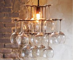 Old wine glasses make an awesome chandelier... #upcycle #recycle