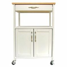 "Featuring locking casters for easy entertaining, this classic kitchen cart offers extra counter space and essential storage for preparing your signature salads and entrees with ease.  Product: Kitchen cartConstruction Material: WoodColor: WhiteFeatures:  One storage drawerOpen shelfSupports up to 150 pounds Dimensions:  Cabinet: 15.75"" H x 20"" W x 14.5"" D  Drawer: 3"" H x 18.5"" W x 13.25"" D  Open Shelf: 9.5"" H x 21.75"" W x 16.5"" D  Overall: 34.25"" H x 23.5"" W x 17.5"" D Note: Assembly requir…"
