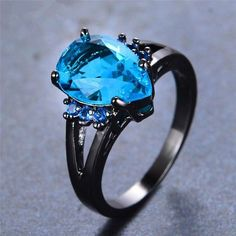 Elegant Water Drop Lake Blue Zircon Ring ($31) ❤ liked on Polyvore featuring jewelry, rings, blue jewellery, gold filled ring, blue zircon jewelry, blue wedding rings and blue zircon ring