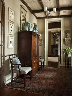 Elegant and classy but lived-in. Antique but not sterile. Ideally would be a little softer.
