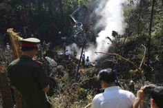 Rescue workers search an air force plane crash site near Nadee village, in Xiang Khouang province in the north of the country May REUTERS First Novel, Bury, Romance Novels, Southeast Asia, Laos, Around The Worlds, Romantic, Concert, Pictures