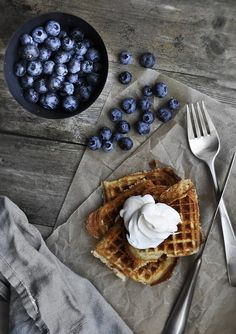 waffles every weekend please Perfect natural light, love the grey cloth with the grey table top. The blueberries bring perfect coloration along with the waffles.