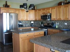 Terra Ombra with Cosmic Mix high backsplash. By Granite Transformations