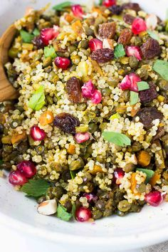 Moroccan Style Lentil and Quinoa Salad with raisins, pomegranate, almonds and parsley