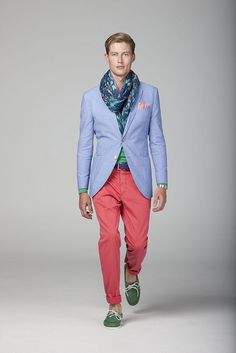 Shop this look on Lookastic:  http://lookastic.com/men/looks/scarf-pocket-square-blazer-long-sleeve-t-shirt-watch-chinos-boat-shoes/9794  — Navy and Green Print Scarf  — Pink Pocket Square  — Light Blue Blazer  — Green Long Sleeve T-Shirt  — Gold Watch  — Red Chinos  — Green Suede Boat Shoes