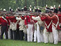 British regulars ready to fire. Find out why they wore red by reading our blog. #Warof1812